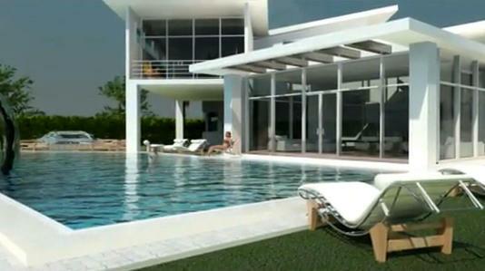Casa lujosa con piscina y una mujer tomando el sol